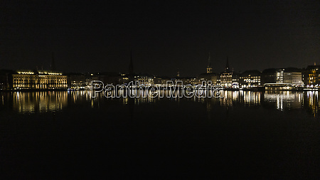 hamburg cityscape illuminated in elbe river