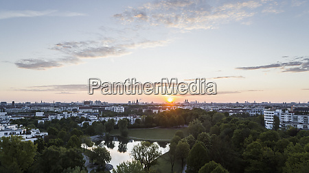 sunset over munich cityscape and westpark