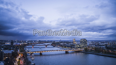 cologne cityscape and illuminated bridges over