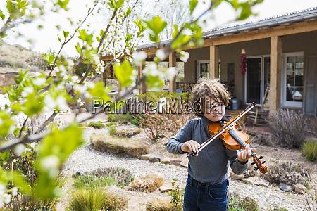 6 year old boy playing violin