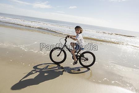 six year old boy biking on
