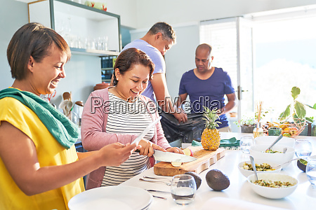 happy mature couple friends cooking in