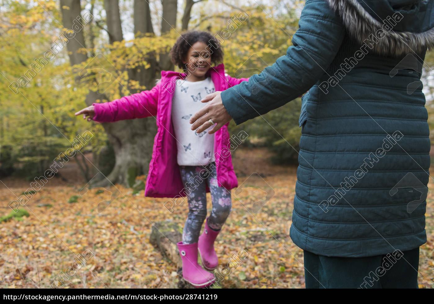 happy, girl, balance, on, fallen, log - 28741219