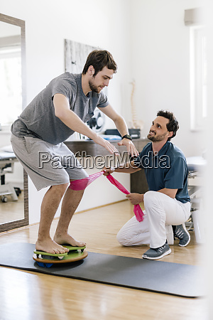physiotherapist, assisting, patient, , practicing, on, balance - 28743017