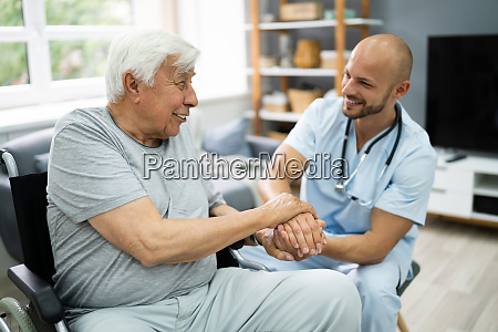 health care patient holding hand