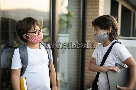 siblings, wearing, masks, outdoors - 28761786