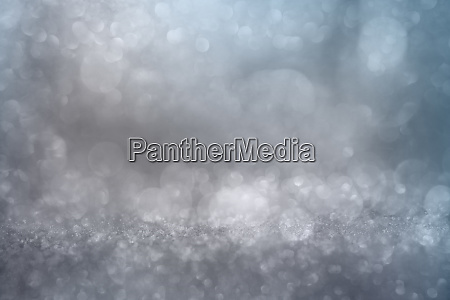 bokeh effects on silver glittering background