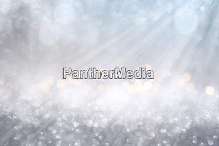 bokeh effects on silver glittering background