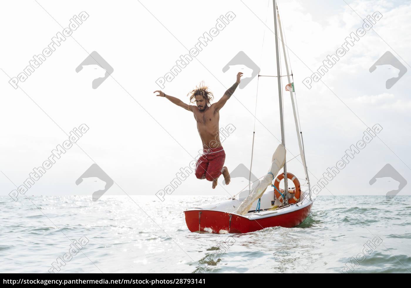 man, jumping, off, sailboat - 28793141