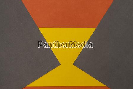 orange grau und gelb gefaerbtpapier hintergrund