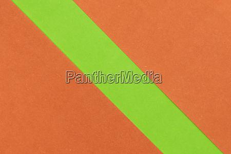 gruener und orangefarbener papierhintergrund