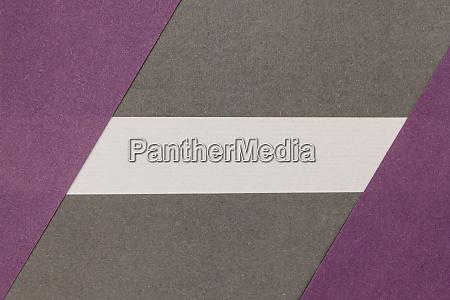 weisser grauer und lilafarbener papierhintergrund
