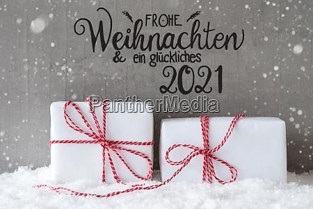 zwei weisse geschenke schnee schneeflocken zement