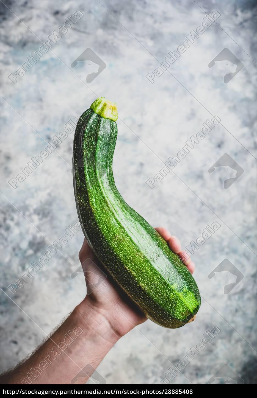 hand, holding, zucchini - 28885408
