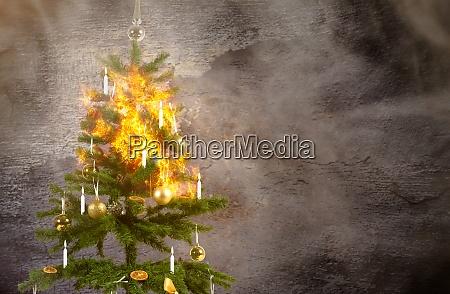konzeptbild eines brennenden weihnachtsbaumes wegen der