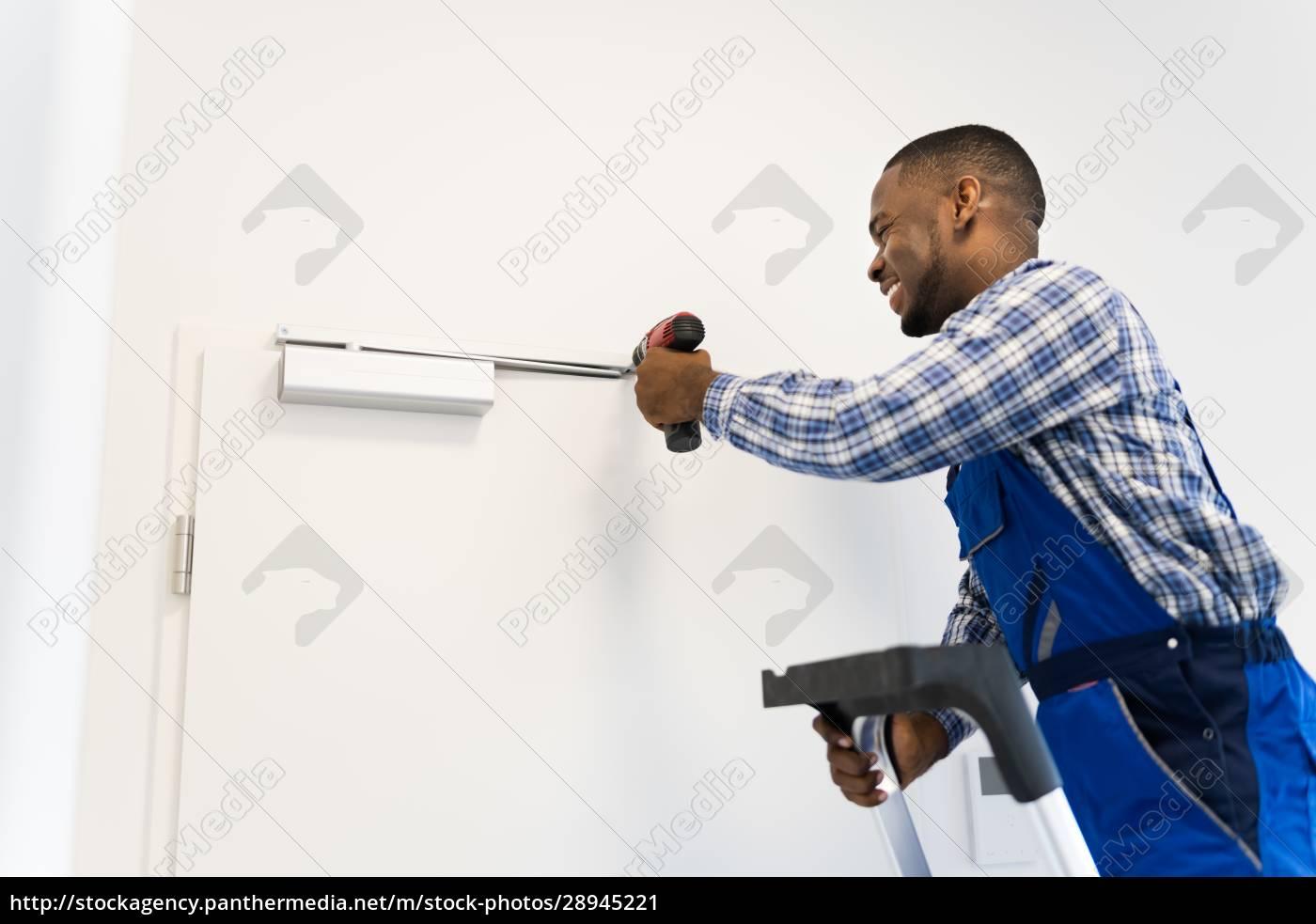 african, man, installing, and, fixing, door - 28945221