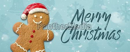 weihnachtshintergrund mit einem lebkuchenmann frohe