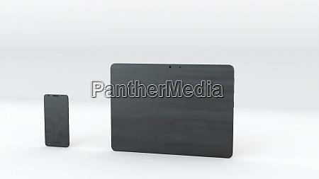 tablet und smartphone mit gruenem bildschirm