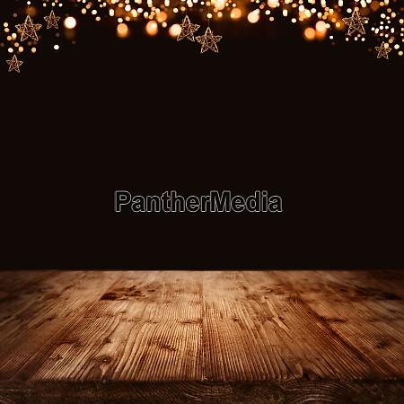 holzhintergrund mit weihnachtssternen