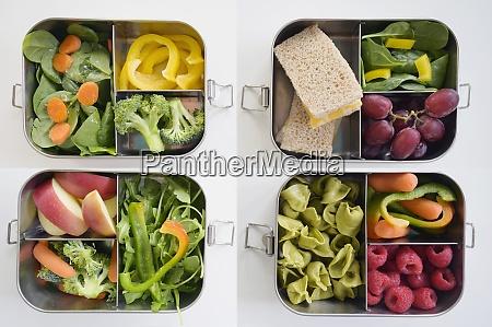 lunchboxen mit frischem gemuese und obst