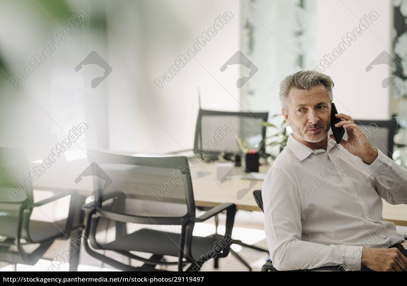 businessman, talking, on, phone, while, sitting - 29119497