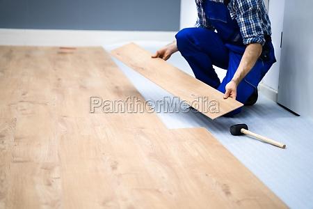 worker installing home floor