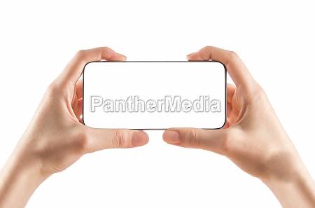 junge maedchen haende halten schwarzes smartphone