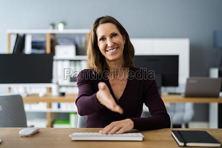 executive woman welcoming handshake