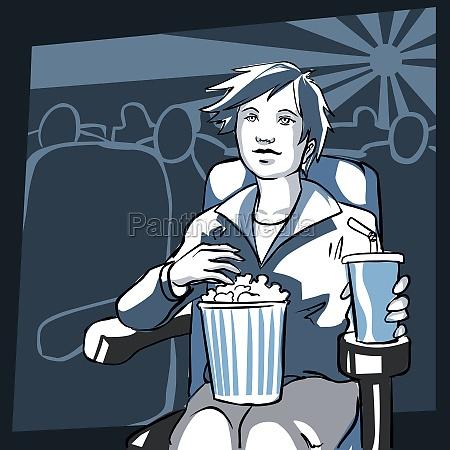 frau sitzt in einem kino