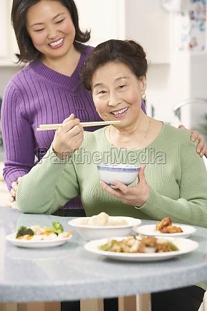 portrait, of, a, senior, woman, eating - 29590036