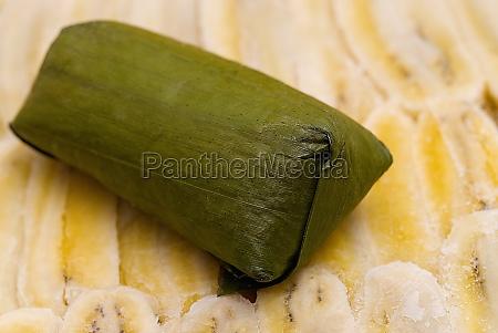 close-up, of, rice, dumpling, on, banana - 29598285
