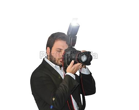junge fotograf fotografiert mit der kamera
