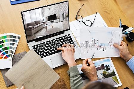 hausdesigner und dekorateure mit computer