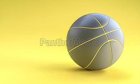 grauer basketballball auf gelbem hintergrund