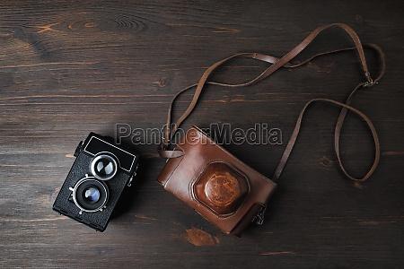 vintage foto kamera auf holz tisch