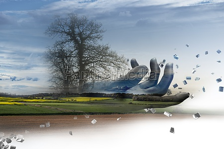 digitale hand ueber laendliche landschaft