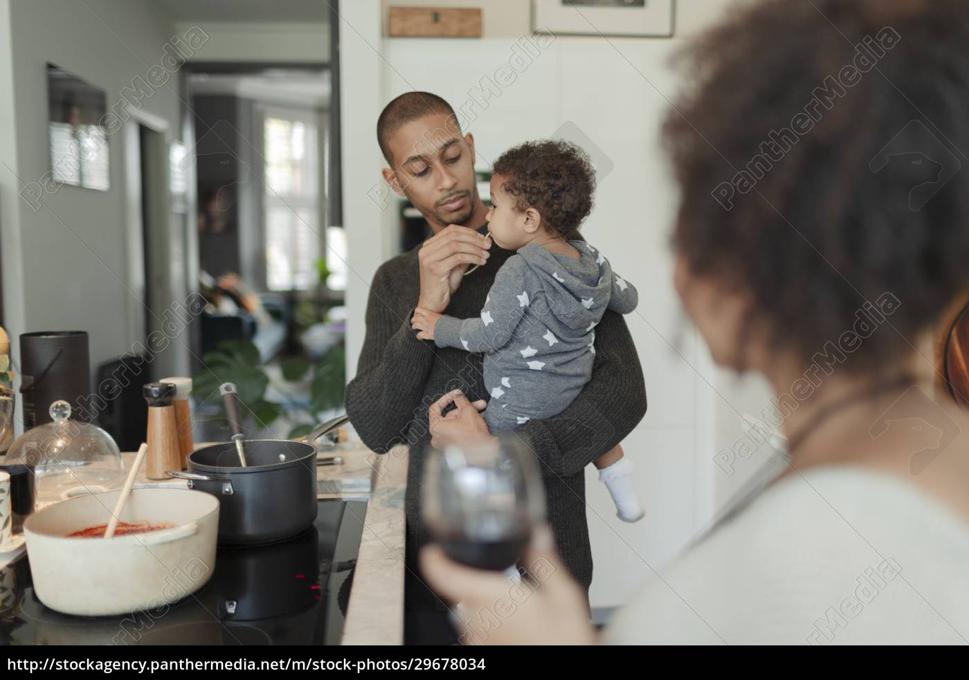 father, holding, baby, daughter, and, cooking - 29678034