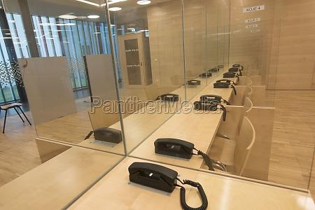 transparent, dividing, walls, with, telephones - 29693186
