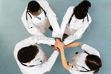 diverse medical staff team hands stack