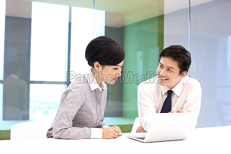 two, business, people, communicate, at, work - 29749071