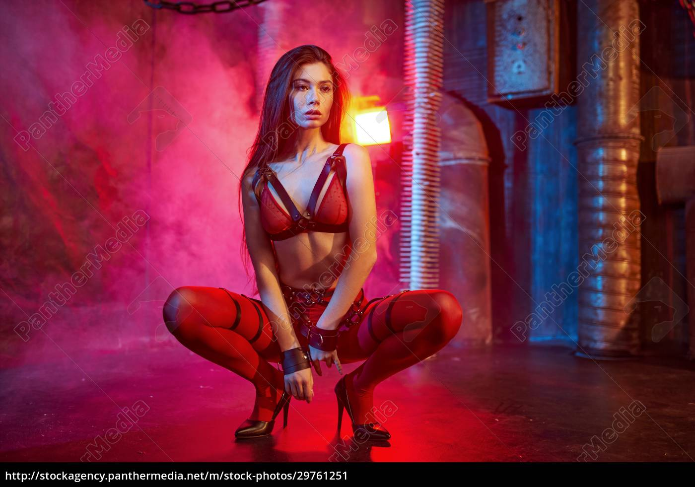 sexy, model, in, red, bdsm, suit - 29761251