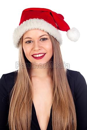 junge frau mit weihnachtshut und roten