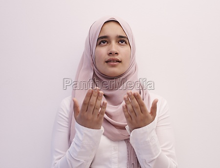 female, muslim, praying, with, opend, hands - 29804153