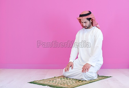 young, arabian, muslim, man, praying, on - 29806313