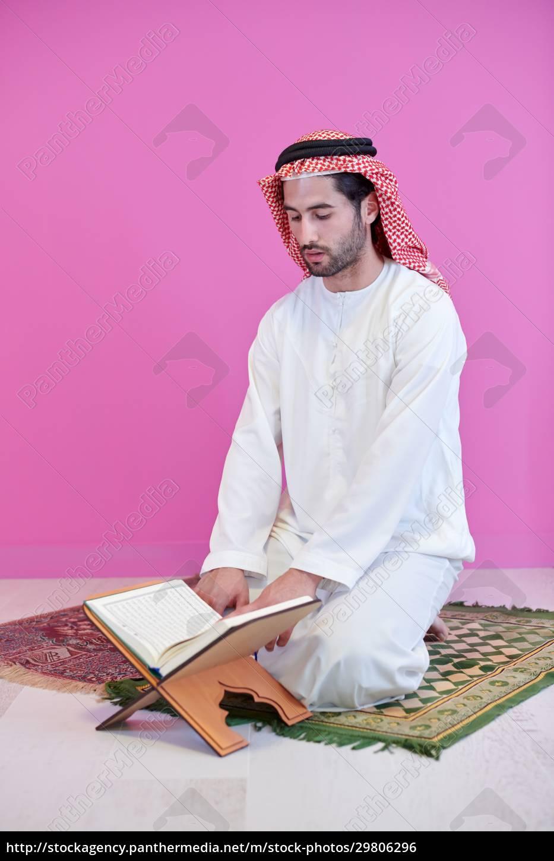 young, arabian, muslim, man, reading, quran - 29806296