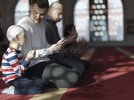 father, and, son, in, mosque, praying - 29811034