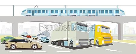 autobahnbruecke mit schnellzug lkw bus und