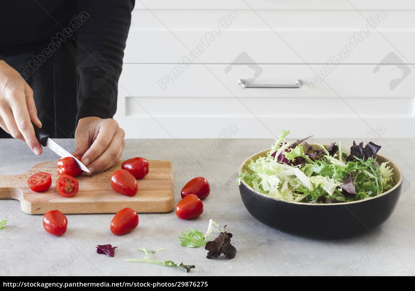 cutting, cherry, tomatoes, on, wooden, board - 29876275
