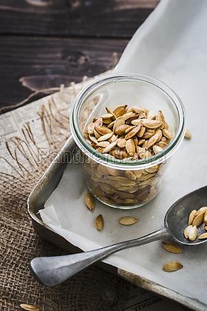 a, jar, of, roasted, pumpkin, seeds - 29887361