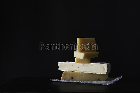 a, stack, of, various, cheeses - 29890786